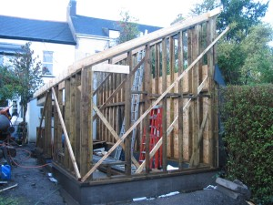 The timber frame is in place and the window opes have been formed.